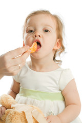 Girl eating tangerine