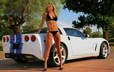 Blond model in a bikini posed with a hot car.