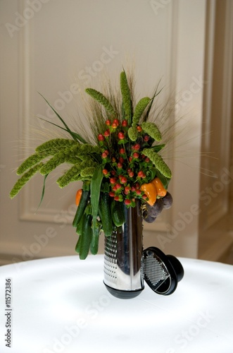 poster of Creative centerpiece with vegetables and foliage