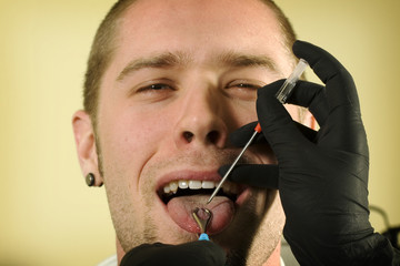 Man about to get his tongue pierced
