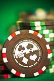 gambling chips on green cloth poster