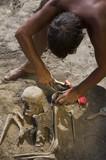 Archaeologist excavating prehistoric grave poster