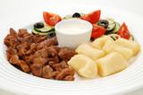 Grilled meat, dumplings and vegetable salad poster