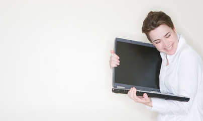 Businesswoman hugging laptop