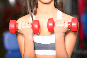 The girl with dumbbells