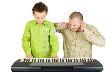 Kid playing piano badly