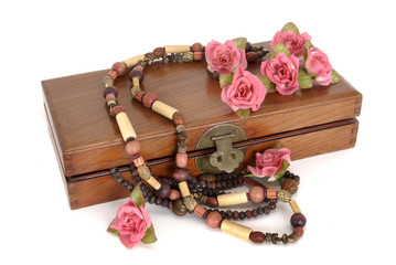Wooden box with necklace and roses