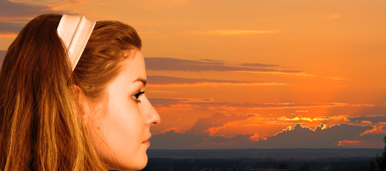 young girl at a sunset