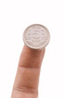 Indian coin on a finger