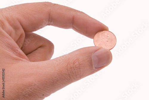 Coin held by two fingers