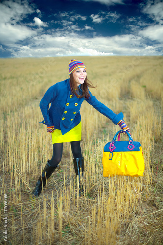 The stylish young fashionable girl a bag