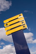 Blank Blue and Yellow Sign over Cloudy Sky
