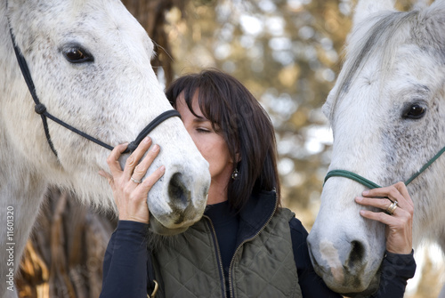 Woman Showing Affection to her Horses