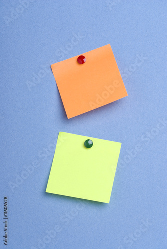 Green and orange pinned postits