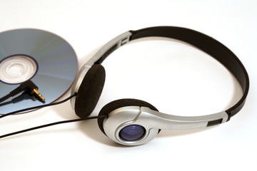 stereo head phones with CD on a white background