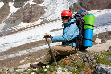 Backpacker girl with ice-axe