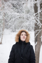 breath of girl on winter day in park showing how cold is outdoor