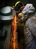Tradesman at work grinding steel. poster