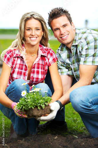 couple planting flowers