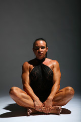 Sitting woman bodybuilder