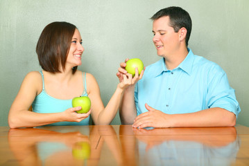 Young Adults Caucasian Couple Sharing Green Apple