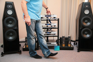 Man and hi-end audio system