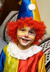 The boy wearing clown