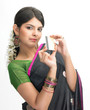 Woman in sari holding credit  card