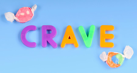 Magnetic letters spelling crave