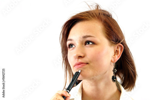 cogitative woman with pen