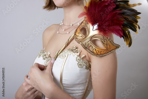 Girl in evening dress with a carnival mask