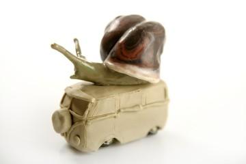Handmade plasticine vw van with snail over