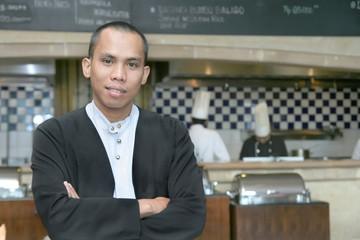 Man in waiter uniform at work smiling