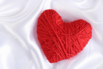 Heart of Knitting on the satin background