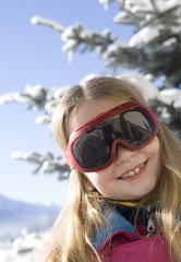 Happy girl with ski glasses