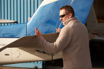 Pilot doing pre-flight checking