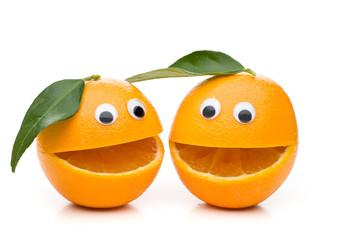 Zwei lustige Orangen mit Gesicht