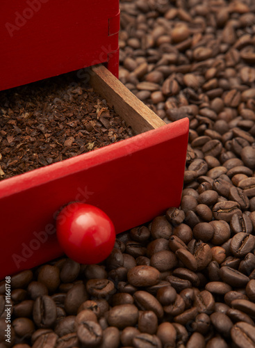 coffee grinder between roasted beans