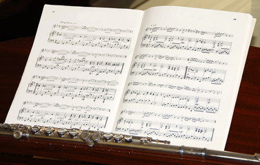 sheet of music and flute