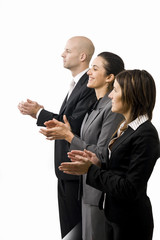 Businessteam in a row clapping