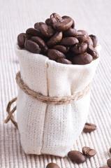raw coffee in small sack