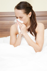 woman in the bed with flu