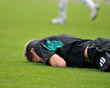 Young soccer man lying on the grass