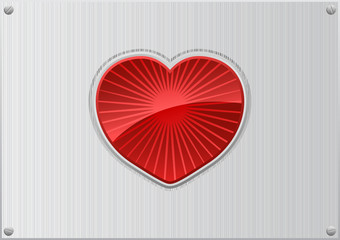 Red heart on aluminum background