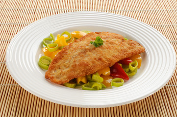 Fried fish fillet with vegetables