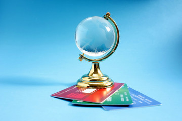 Glass globe with credit cards