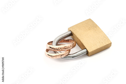 isolate padlock with golden wedding rings