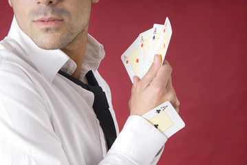 poker player with aces and an ace in his sleeve