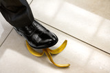 men shoe stepping on banana peel