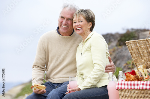 Couple Eating An Al Fresco Meal At The Beach